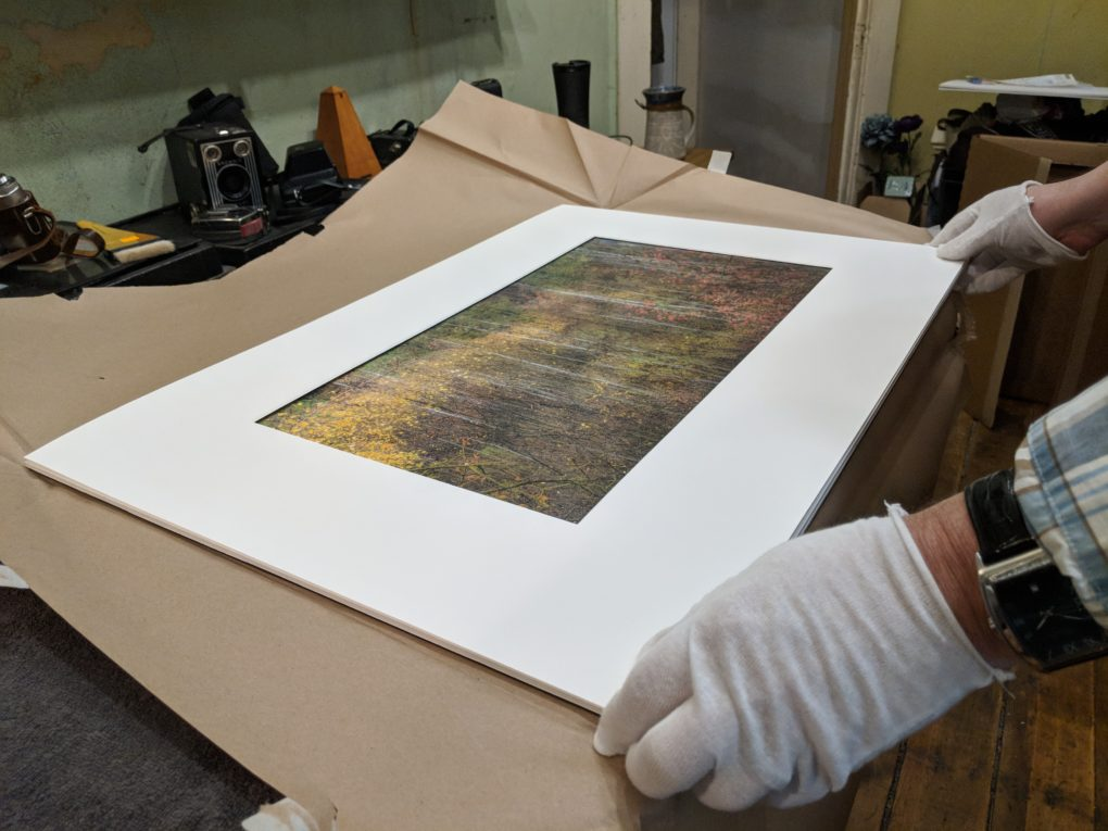 Image of me matting a digital photograph and preparing it for framing.