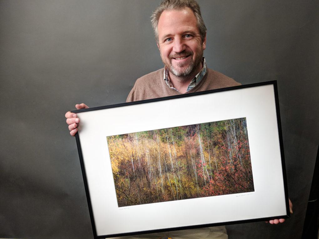 Image of me holding a framed artwork after I have put everything together.